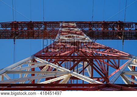High Voltage Tower Below. Concept Of High Voltage Construction. High Voltage Pylon
