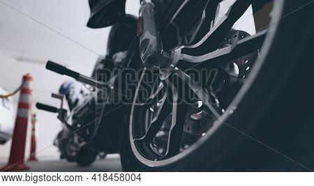 Closeup Aluminum Alloy Wheel Of Motorcycle Parked At Car Parking Lot. Steel Rims. Mag Wheels Of Moto