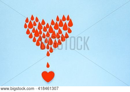 Many Drops Of Blood Filling The Heart On A Blue Background, World Blood Donor Day, Charity And Care,