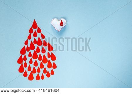 Many Drops Of Blood In The Form Of A Drop On A Blue Background, World Blood Donor Day, Charity And C