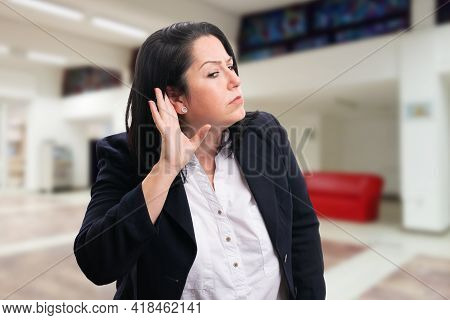 Curious Businesswoman At Corporate Office Building Making Eavesdropping Listening Gesture Hand To Ea