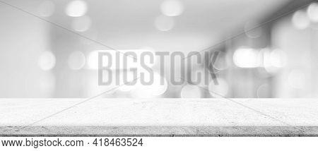 Empty White Cement Table Over Blur Store Background, Product Display Montage, Black And White Tone,