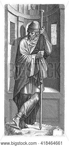 The Apostle James the Greater standing in front of a niche leaning on his pilgrim's staff.