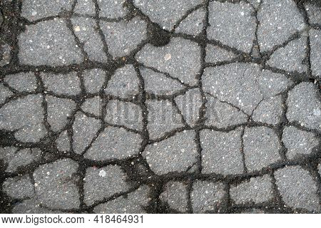 Broken Asphalt Texture. Abstract Architectural Background And Texture For Design.