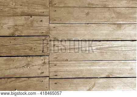Wall Made Of Uncutted Weathered Wood Boards In Brown Tone. Abstract Architectural Background And Tex