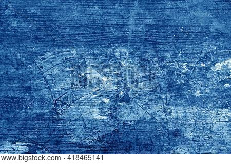 Old Rusted And Stained Floor Pattern In Navy Blue Tone. Background And Texture.