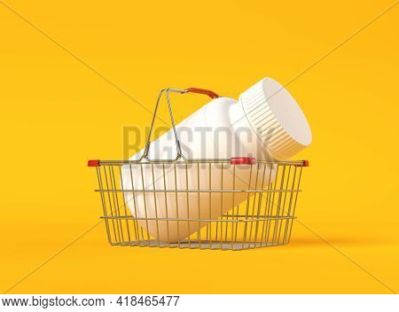 Pill Bottle In A Metal Shopping Basket On Yellow Background With Copy Space. Medicine Concepts. Mini