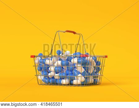 Heap Of Blue-white Pills In A Metal Shopping Basket On Yellow Background With Copy Space. Medicine C