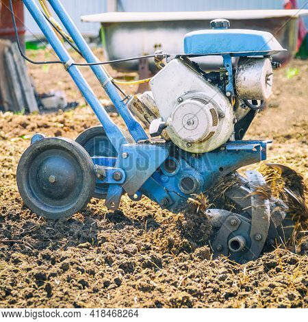 Garden Tillers Cultivator For Tillage. Gardening. Selective Focus