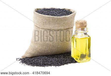 Black Sesame Essential Oil. Glass Bottle Of Black Sesame Oil. Black Sesame In A Sack Of Isolated On