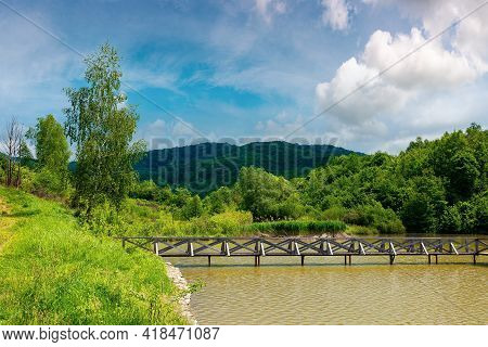 Lake Among Mountain Landscape In Spring. Beautiful Countryside Scenery With Forest On The Shore. Clo