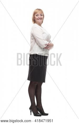 Mature business woman in a white blouse and black skirt .
