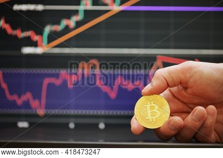 Galati, Romania - April 24, 2021 Studio Shot Of Golden Bitcoin Currency With Growth Chart