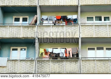 Balconies Of Panel Building In Ghetto With Clothes Hanging On Ropes And Drying.