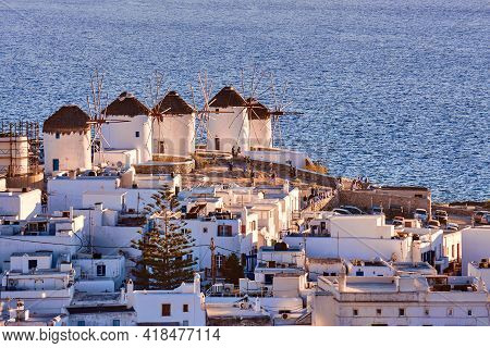 Beautiful Close View Of Famous Traditional White Windmills On Hill Top, Mykonos, Greece. Whitewashed