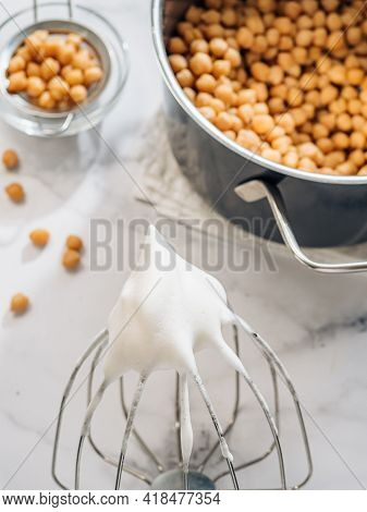 Whipped Aquafaba On Planetary Mixer Whisk, Vertical. Chickpea Water Brine Aquafaba Whipped. Egg Repl