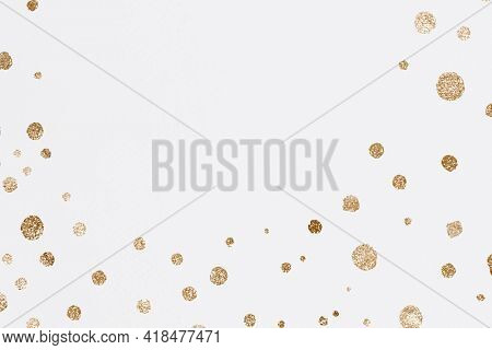 Glittery gold dots celebration background