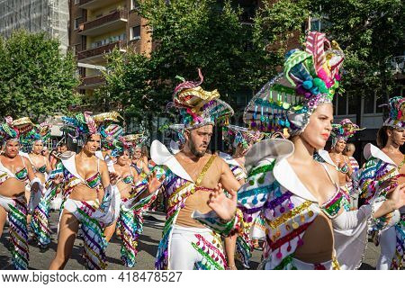 Barcelona - Spain. June 29, 2019: A group of energetic young men and women in sexy provocative latinamerican costumes dance