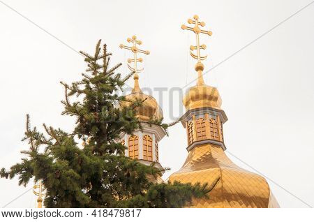 Domes with a cross of a Christian church. Christian cross. Religion and culture. Orthodox church. Blue sky.