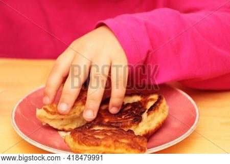 Little Girl Eating Pancakes For Breakfast. Healthy Baby Food.