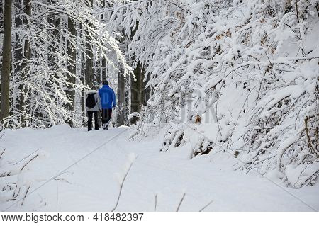 People On Winter Adventure Trip On Javorový, Mountains In Beskydy