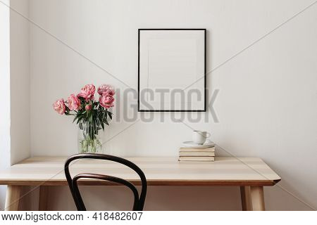 Living Room, Indoor Still Life. Empty Picture Frame Mockup On Beige Wall. Wooden Table And Old Chair
