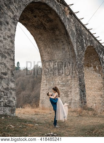 Newly Married Wedding Couple Hugging On Nature