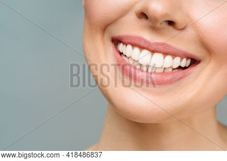 Perfect Healthy Teeth Smile Of A Young Woman. Teeth Whitening. Dental Care, Stomatology Concept.