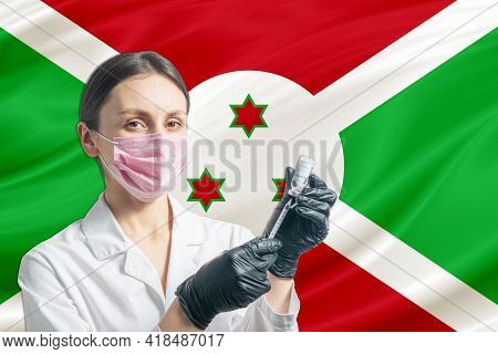Girl Doctor Prepares Vaccination Against The Background Of The Burundi Flag. Vaccination Concept Bur