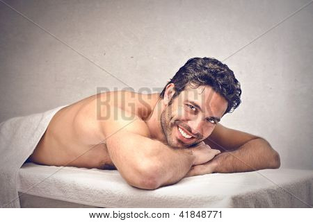 young man relaxes lying down for massage
