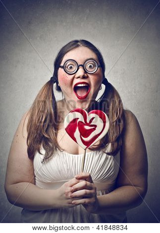 young fat woman surprised with glasses and lollipop