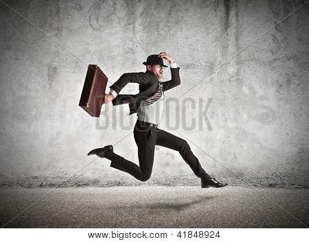 stressed businessman running