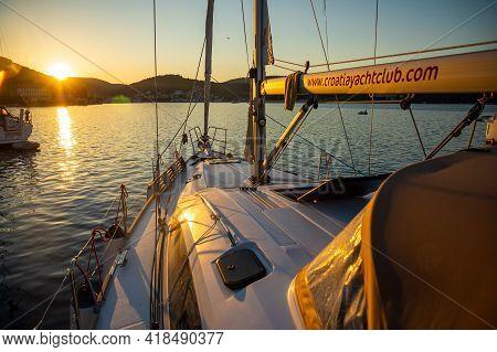 Vis, Croatia - 31.03.2021: Luxury Yacht In The Marina At Sunset Lights In Croatia