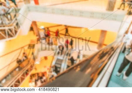 Shopping Mall Building Blurred Background. People Shopping In Modern Commercial Mall Center. Interio
