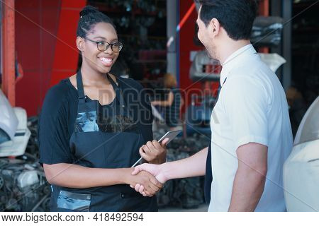 Diversity Of Two People, Caucasian Business Manager And African Worker Woman Are Smiling And Shaking
