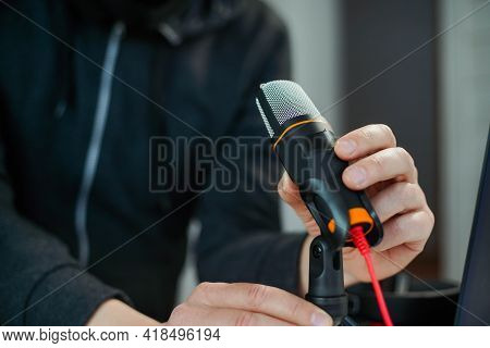 Closeup Hand Of Young Man Podcast Creator Or Radio Host Taking Microphone