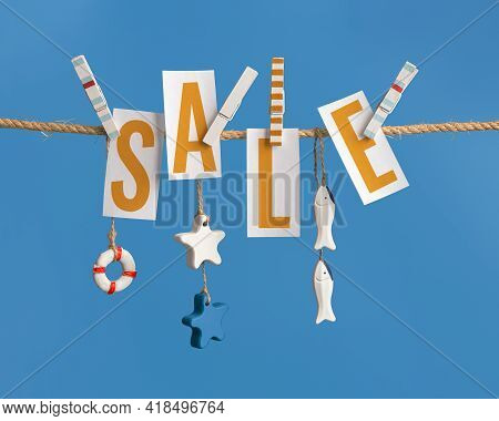 Summer Poster With Lettering Sale, Inscription On White Pieces Of Paper Hanging With Clothespins On