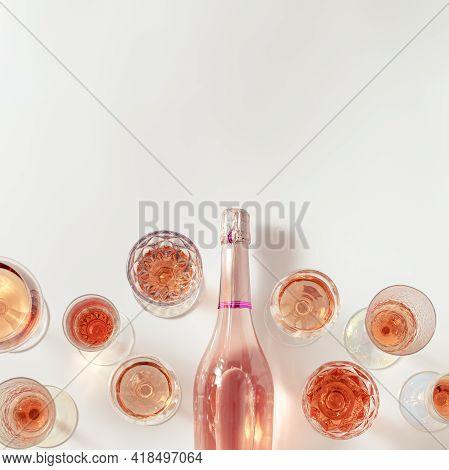 Rose Wine Assortment In Crystal Glasses, Bottle Of Rose Champagne Sparkling Wine On Light Background