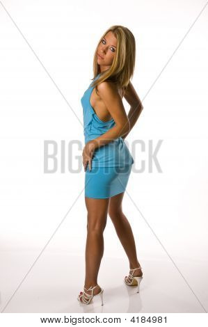 Beautiful Woman In Blue Dress Standing From Back