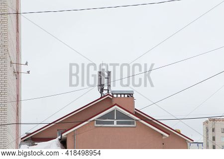 Telecommunication Antenna Next To A Residential Building. Cellular And Telephone Communications. Chi