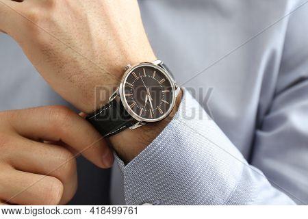 Man Wearing Luxury Wrist Watch With Leather Band, Closeup