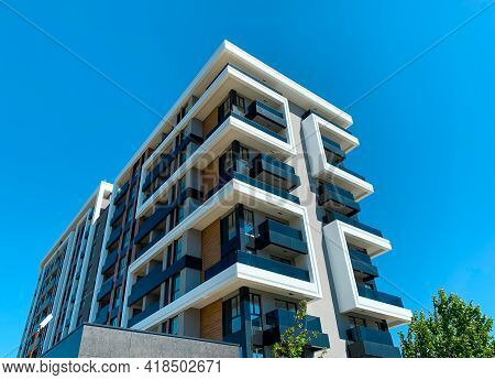 Modern Residential Building With Flats. Contemporary Multi Store Architecture  Planned For Dwellings