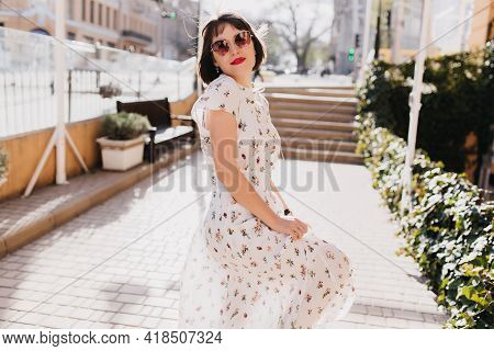 Cheerful Caucasian Lady In Black Sunglasses Walking Around City In Summer Day. Outdoor Shot Of Inter