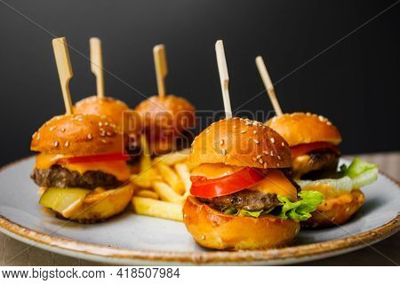Mini Burgers And Fried Potatoes On The Plate