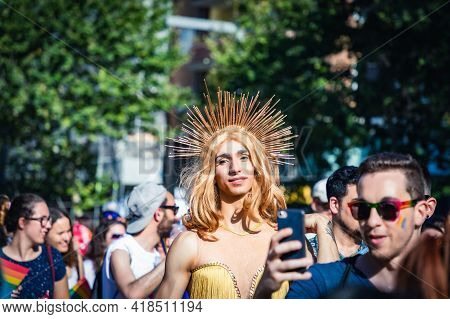 LGTBQ Pride Festival celebration. Barcelona - Spain. June 29, 2019: Blond tall youth crossdresser with a halo over his head
