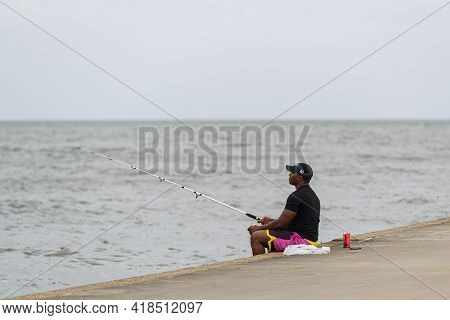 New Orleans, La - October 9: Man Fishes In Lake Pontchartrain On October 9, 2020 In New Orleans, Lou