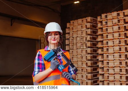 Woman Carpenter Worker At Woodwork Factory, Holding Professional Tool.