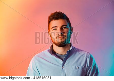 Portrait Of Young Man In The Red And Blue