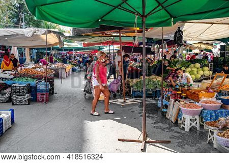 Alanya, Turkey - October 23, 2020: Alanya Open Air Farmer Food Market. Shoppers Walk Between Tables