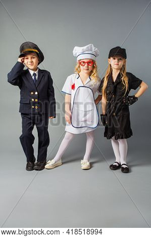The Little Kids Pose In The Costumes Of Different Profession